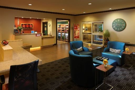 Towneplace Front Desk and Lobby Area with Blue Arm Chairs